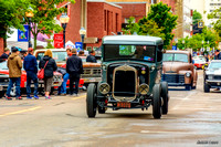 1931 Ford pickup hot rod entering downtown
